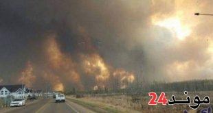 الآلاف من الامريكيين يجبرون على الفرار من أحياء لوس أنجلس نتيجة الحريق المهول